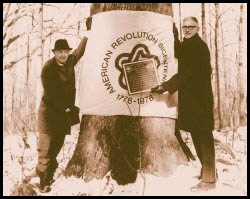 Bob McConnell and Hyland Johns dedicate a bicentennial tree, 1976.